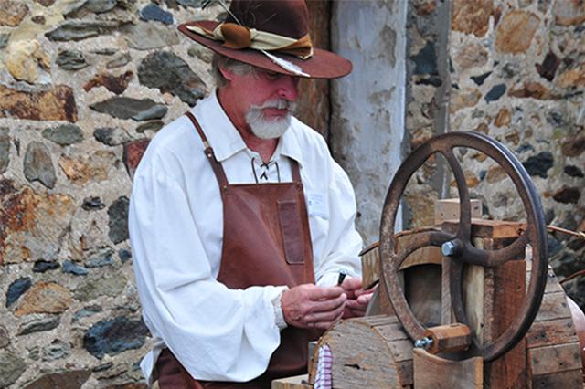 Man at a grinding wheel